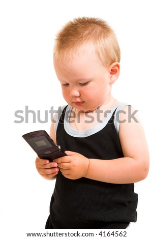 Young child with a phone isolated on the white background