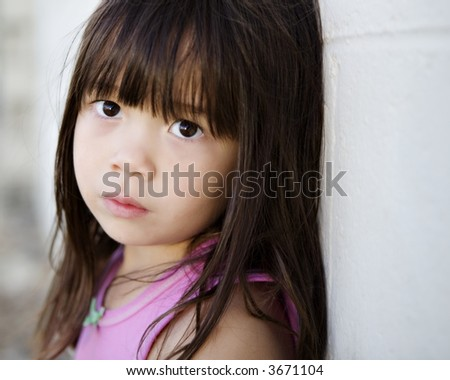 Young Child with a Sad Expression - stock photo