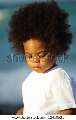 Young child with Afro - stock photo