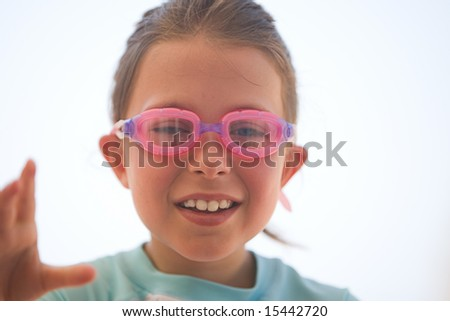 Young Child with Swimming Goggles - stock photo