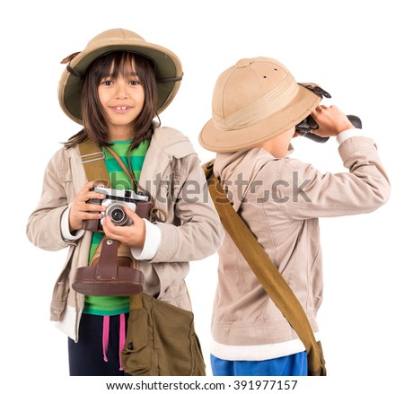 Young childen with binoculars and camera playing Safari isolated in white