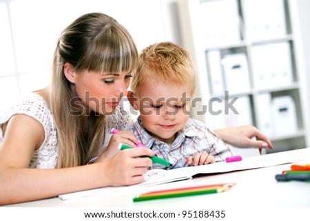 young children engaged in drawing