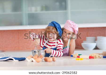Young Children having fun in the Kitchen - stock photo