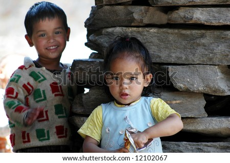 Young children posing with smiles in Northern India, representing positive aspects of society in developing countries - stock photo