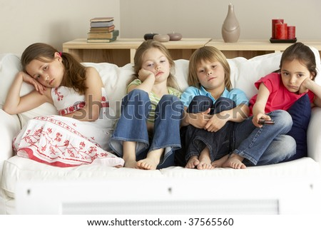 Young Children Watching Television at Home - stock photo