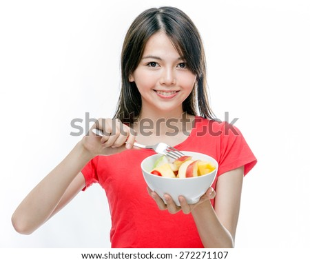 Young Chinese woman holding bowl of fruit