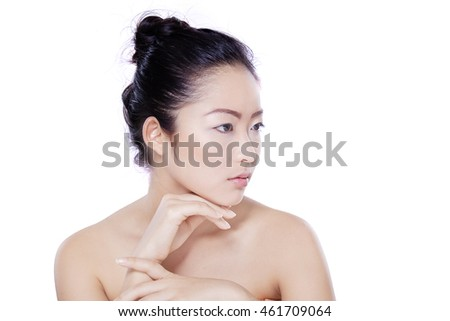 Young chinese woman with beautiful face and natural skin after spa treatment, shot in the studio