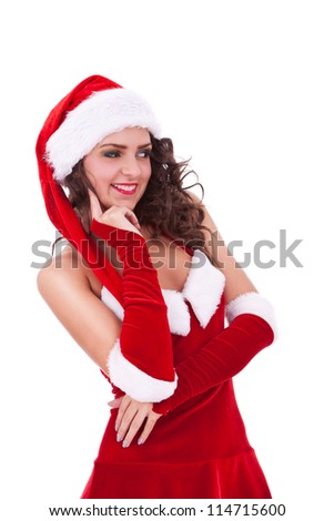 young christmas woman looking pensively to her side, with her hand on her chin, and smiling - stock photo