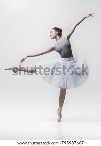 Young classical dancer isolated on white background.