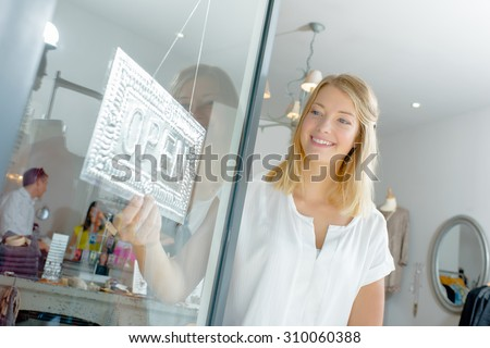 Young clothing boutique worker - stock photo