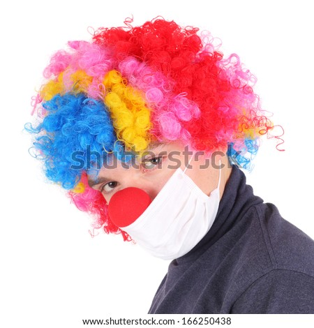 young clown in the protective medical mask