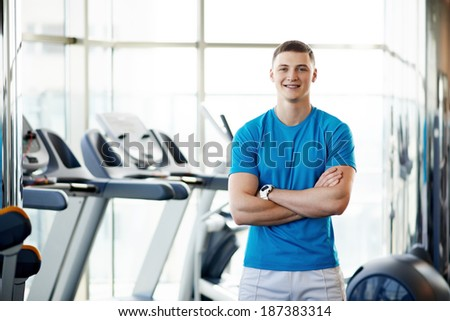 young coach in the gym - stock photo