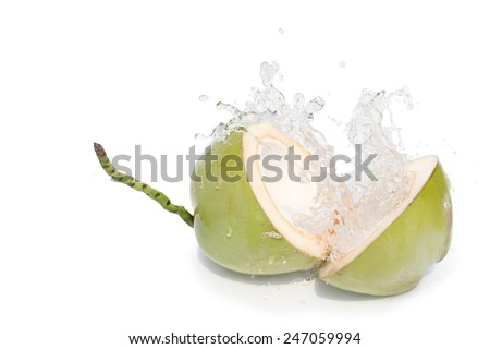 young coconut cut haft clear coconut juice  splashing. The pure white light Invited to enjoy a relaxing vacation at the summer time. I isolated on white background - stock photo
