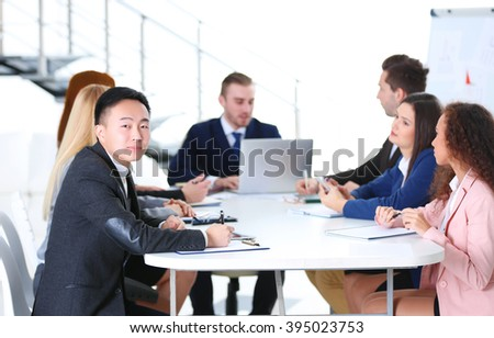 Young colleagues sitting at the business meeting in the office