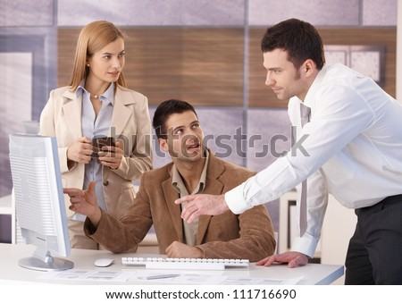 Young colleagues teamworking in office, having discussion. - stock photo