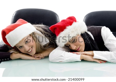 young colleagues wearing christmas hat on an isolated background - stock photo
