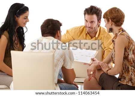 Young colleagues working in team, smiling. - stock photo