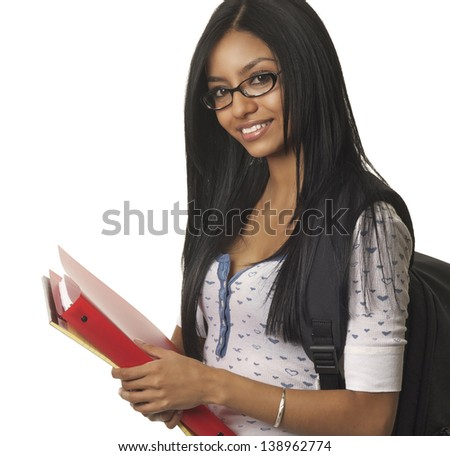 Young college school student smiling happily carrying books and supplies - stock photo