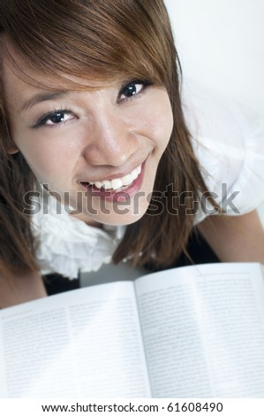 Young college student is studying, face looking up. - stock photo