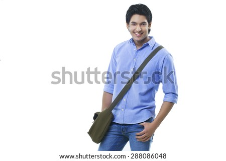 Young college student standing over white background