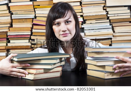 Young college student with her books - stock photo