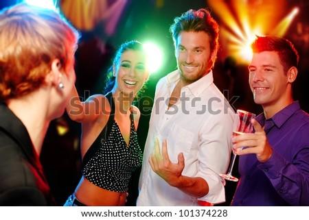 Young companionship having fun in discotheque. - stock photo