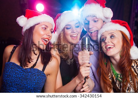 young company celebrates the holiday with coctail in the hands - stock photo