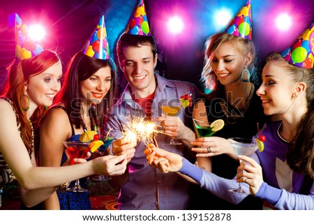 young company celebrates the holiday with fireworks in the hands - stock photo