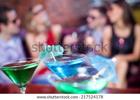 young company having fun in the night bar at the table - stock photo
