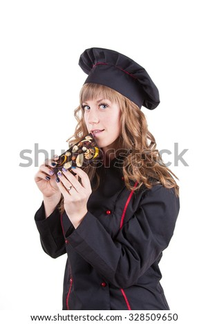 Young confectioner shows a bar of chocolate. Young beautiful girl dressed as pastry with chocolate in hand is isolated on a white background