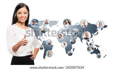 Young, confident and beautiful customer support operator working in a call center. World map on a background.  International call center concept.