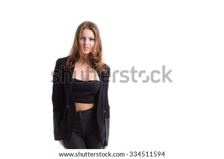 Young confident beautiful woman in black clothes.