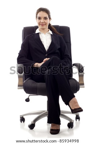 Young confident business woman sitting on a chair isolated on white - stock photo