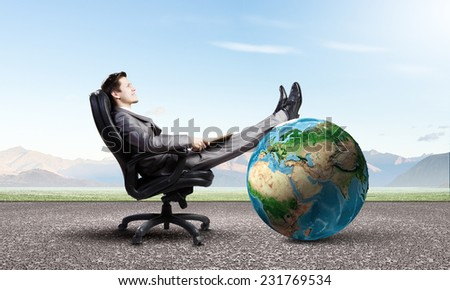 Young confident businessman sitting in chair with book in hands. Elements of this image are furnished by NASA - stock photo