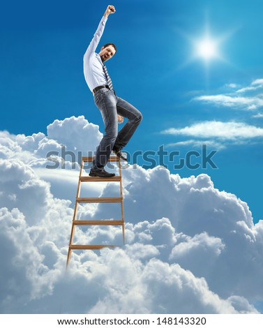 young confident businessman standing at the ladder high in the sky reaches the top / young man in shirt and tie pulls his hand up to the sky on top of the ladder on heaven - stock photo