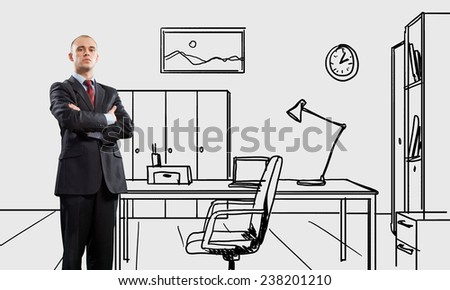 Young confident businessman standing in drawn office - stock photo