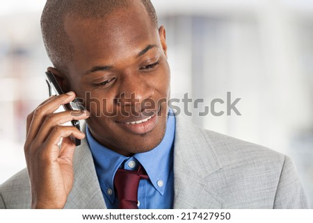 Young confident businessman talking on the phone - stock photo