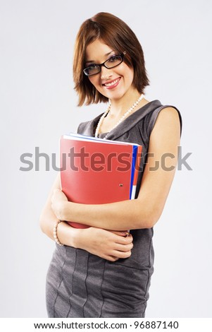 Young confident businesswoman with folders and documents