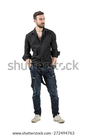 Young confident fashion model in black shirt looking away. Full body length portrait isolated over white background.