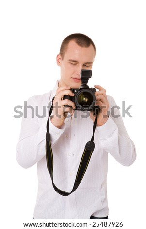 young confident Photographer choosing right shot isolated - stock photo