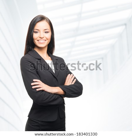 Young, confident, successful and beautiful business woman in office