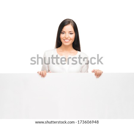 Young, confident, successful and beautiful business woman with the blank billboard isolated on white - stock photo
