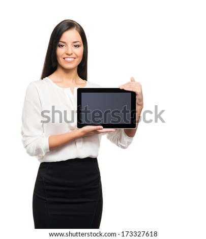 Young, confident, successful and beautiful business woman with the tablet computer isolated on white - stock photo