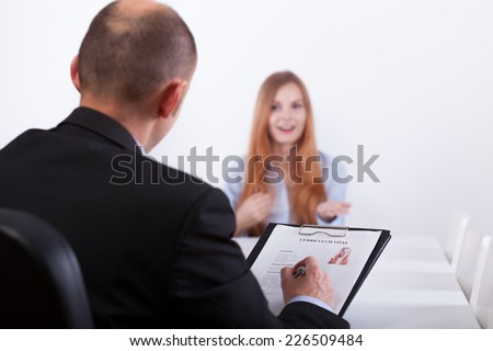 Young confident woman and her job interviewer