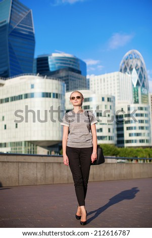 Young confident woman in business district of Paris