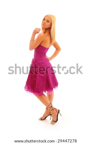 Young confident woman with blonde hair wearing a bright purple party dress on a white background.