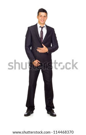 Young Confident young business man standing against white background - stock photo
