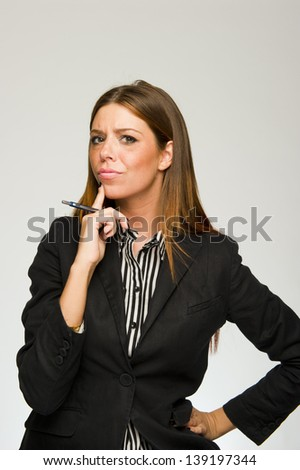 Young confused business woman thinking on white background - stock photo