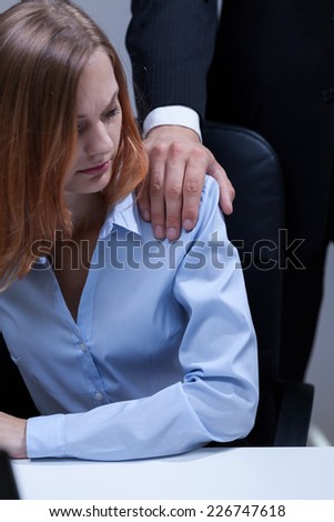 Young confused employee and her unprofessional boss - stock photo