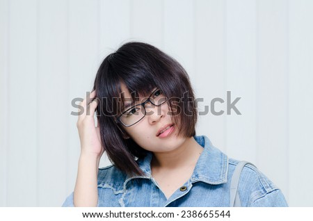 Young confused student and looking at camera. - stock photo
